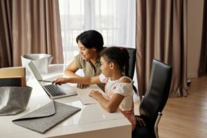 Mother helping her daughter take online classes